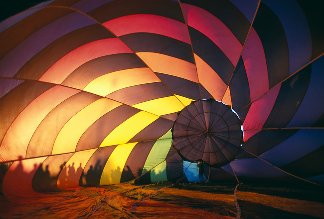 Sunlight shines through a hot-air balloon with silhouettes of people, Colorado Springs, CO