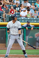 Leury Bonilla (4) of the Tacoma Rainiers at bat against the Salt Lake Bees in Pacific Coast League action at Smith's Ballpark on July 8, 2014 in Salt Lake City, Utah.  (Stephen Smith/Four Seam Images)
