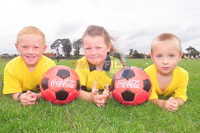 Curtis Sullivan, Natisha Smith and Darren Gallagher taking part in the Tom Burke Memorial Soccer Camp in Rathmullen sponsored by Drogheda Concentrates.Photo Fran Caffrey/Newsfile.ie..This picture has been sent to you by:.Newsfile Ltd,.3 The View,.Millmount Abbey,.Drogheda,.Co Meath..Ireland..Tel: +353-41-9871240.Fax: +353-41-9871260.GSM: +353-86-2500958.ISDN: +353-41-9871010.IP: 193.120.102.198.www.newsfile.ie..email: pictures@newsfile.ie..This picture has been sent by Fran Caffrey.francaffrey@newsfile.ie
