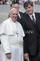 Pope Francis, pope's assistant Sandro Mariotti, during his weekly general audience in St. Peter square at the Vatican, Wednesday.April 2 2014.