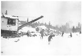 New Mexico Lumber Co.'s American log loader and crew loading logging cars on a snowy day.<br /> New Mexico Lumber Co.  San Juan National Forest, CO  Taken by Long, Morris - ca. 1928