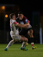 Harlequins' Francis Saili is tackled by Exeter Chiefs' Joe Simmonds<br /> <br /> Photographer Bob Bradford/CameraSport<br /> <br /> Gallagher Premiership Round 9 - Harlequins v Exeter Chiefs - Friday 30th November 2018 - Twickenham Stoop - London<br /> <br /> World Copyright © 2018 CameraSport. All rights reserved. 43 Linden Ave. Countesthorpe. Leicester. England. LE8 5PG - Tel: +44 (0) 116 277 4147 - admin@camerasport.com - www.camerasport.com