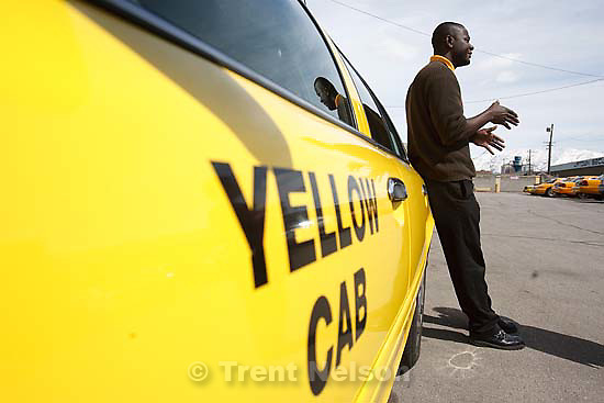 Salt Lake City - Opoku Agyemang is a cab driver with Yellow Cab, Friday March 27, 2009. Salt Lake City is discussing plans to cut the number of taxis by 25 percent. Drivers say people relying on the service will suffer, particularly the elderly and disabled who need service during the night and in different areas of the county..
