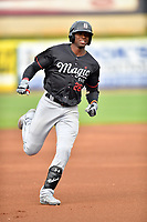 Birmingham Barons center fielder Luis Robert (26) runs to third base after hitting a triple during a game against the Tennessee Smokies at Smokies Stadium on May 15, 2019 in Kodak, Tennessee. The Smokies defeated the Barons 7-3. (Tony Farlow/Four Seam Images)