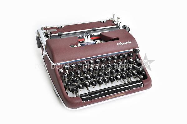 Olympia SM4 portable typewriter. Serial Number 1309237. Colour: Burgundy maroon crackelure matt finish crackle paint. Manufactured: Olympia Werke AG. Wilhelmshaven, West Germany 1958