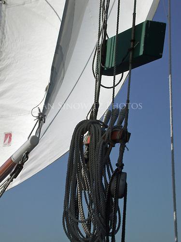 Jibs and lightboard on a gaft rig sloop.