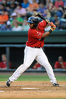 Third baseman Rafael Devers (13) of the Greenville Drive bats in a game against the Augusta GreenJackets on Thursday, June 11, 2015, at Fluor Field at the West End in Greenville, South Carolina. Devers is the No. 6 prospect of the Boston Red Sox, according to Baseball America. Greenville won, 10-1. (Tom Priddy/Four Seam Images)