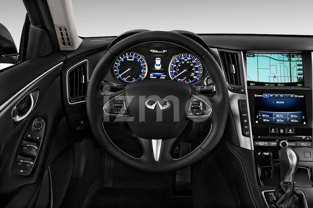 Steering wheel view of a 2014 Infiniti Q50 Sedan