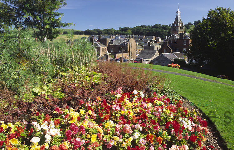 Summer flowers in McJerrow Park Lockerbie looking down on town hall Scotland UK