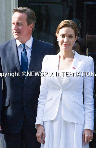10.06.2014, LONDON: ANGELINA JOLIE VISITS N0.10 DOWNING STREET<br /> ahead of the start of the End Sexual Violence In Conflict Summit in London.<br /> Jolie met with Britsh Prime Minister David Cameron and William Hague at No.10<br /> Miss Jolie together William Hague is chairing the summit being held at the Excel, London<br /> Mandatory Photo Credit: Dias/NEWSPIX INTERNATIONAL<br /> <br /> **ALL FEES PAYABLE TO: &quot;NEWSPIX INTERNATIONAL&quot;**<br /> <br /> PHOTO CREDIT MANDATORY!!: NEWSPIX INTERNATIONAL(Failure to credit will incur a surcharge of 100% of reproduction fees)<br /> <br /> IMMEDIATE CONFIRMATION OF USAGE REQUIRED:<br /> Newspix International, 31 Chinnery Hill, Bishop's Stortford, ENGLAND CM23 3PS<br /> Tel:+441279 324672  ; Fax: +441279656877<br /> Mobile:  0777568 1153<br /> e-mail: info@newspixinternational.co.uk