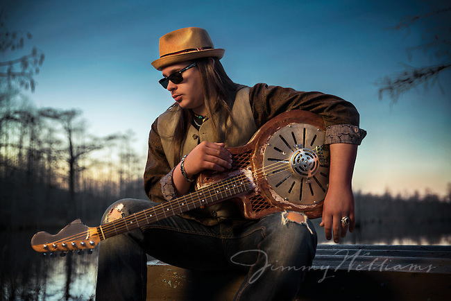 Portrait of Lakota John from Music Makers with a custom made guitar.