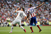 James of Real Madrid and Miranda of Atletico de Madrid during La Liga match between Real Madrid and Atletico de Madrid at Santiago Bernabeu stadium in Madrid, Spain. September 13, 2014. (ALTERPHOTOS/Caro Marin)
