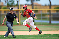 GCL Nationals shortstop Carter Kieboom (9) running the bases behind umpire Jennifer Pawol during a game against the GCL Astros on August 14, 2016 at the Carl Barger Baseball Complex in Viera, Florida.  GCL Nationals defeated GCL Astros 8-6.  (Mike Janes/Four Seam Images)