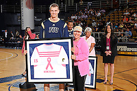 25 February 2012:  FIU's Gilles Dierickx (15) presents a jersey to Nadine Rosario during a ceremony honoring cancer survivors prior to the game.  The FIU Golden Panthers defeated the University of South Alabama Jaguars, 81-74, at the U.S. Century Bank Arena in Miami, Florida.