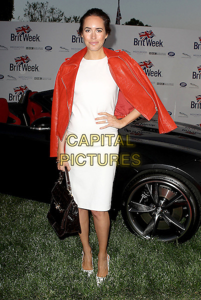 "Louise Roe.7th Annual BritWeek Festival ""A Salute To Old Hollywood"" Launch Party held at the British Consul General's Residence, Los Angeles, California, USA..April 23rd, 2013.full length white dress hand on hip red jacket over shoulders black bag purse .CAP/ADM/KB.©Kevan Brooks/AdMedia/Capital Pictures"