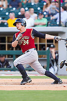 John Ryan Murphy (34) of the Scranton/Wilkes-Barre RailRiders follows through on his swing against the Charlotte Knights at BB&T Ballpark on July 17, 2014 in Charlotte, North Carolina.  The Knights defeated the RailRiders 9-5.  (Brian Westerholt/Four Seam Images)