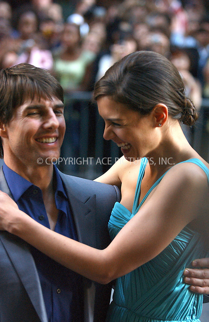 WWW.ACEPIXS.COM . . . . .  ....NEW YORK, JUNE 32, 2005....Tom Cruise and Katie Holmes signing autographs and taking pictures at the premiere of War of the Worlds at the Ziegfeld Theater in New York.....Please byline: Ian Wingfield - ACE PICTURES..... *** ***..Ace Pictures, Inc:  ..Craig Ashby (212) 243-8787..e-mail: picturedesk@acepixs.com..web: http://www.acepixs.com
