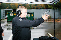 Republican presidential candidate and South Carolina senator Lindsey Graham fires a Sig Sauer P320 pistol during a campaign stop at Sig Sauer Academy in Epping, New Hampshire. Sig Sauer is submitting the pistol to the US government to consider as the standard military service pistol. Sig Sauer Academy is a training facility for domestic and international military and police forces.