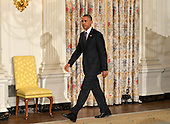 United States President Barack Obama walks to the podium to address the nation from the State Dining Room of the White House, in Washington, DC, as he announces he has authorized military strikes against the Islamic State of Iraq and the Levant (ISIS), August 7, 2014. ISIS has been advancing on the important city of Erbil, Iraq and a civilian humanitarian crisis has developed.<br /> Credit: Mike Theiler / Pool via CNP