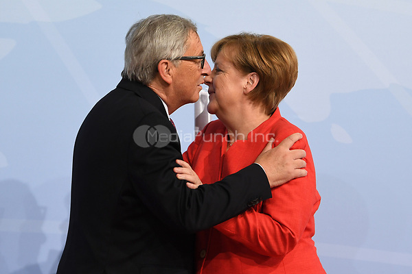 German chancellor Angela Merkel greets Jean-Claude Juncker, the president of European Commission, at the G20 summit in Hamburg, Germany, 7 July 2017. The heads of the governments of the G20 group of countries are meeting in Hamburg on the 7-8 July 2017. Photo: Bernd Von Jutrczenka/dpa-pool/dpa /MediaPunch ***FOR USA ONLY***