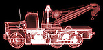 X-ray image of a tow truck (red on black) by Jim Wehtje, specialist in x-ray art and design images.