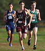 Jack Rosencrans of North Shore, center, moves to the head of pack in the final 500 meters of the the Nassau County boys cross country Class B state qualifier at Bethpage State Park on Saturday, Nov. 4, 2017. He won the 5K race with a time of 16:16.80.