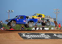 Apr 16, 2011; Surprise, AZ USA; LOORRS driver Greg Nunley (25) leads Rob Naughton (54) during round 3 at Speedworld Off Road Park. Mandatory Credit: Mark J. Rebilas-