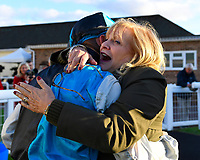 A delighted owner hugs jockey Jason Watson after winning The Signs In Motion Ltd Handicap Stakes  onboard Silver Swift during Twilight Racing at Salisbury Racecourse on 14th September 2018