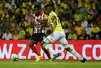 BUCARAMANGA-COLOMBIA, 07-03-2020: Homer Martinez de Atletico Bucaramanga y Luis Gonzalez de Atletico Junior disputan el balon, durante partido entre Atletico Bucaramanga y Atletico Junior, de la fecha 8 por la Liga BetPlay DIMAYOR I 2020, jugado en el estadio Alfonso Lopez de la ciudad de Bucaramanga. / Homer Martinez of Atletico Bucaramanga and Luis Gonzalez of Atletico Junior vie for the ball during a match between Atletico Bucaramanga and Atletico Junior, of the 8th date for the BetPlay DIMAYOR I Legauje 2020 at the Alfonso Lopez stadium in Bucaramanga city. / Photo: VizzorImage / Jaime Moreno / Cont.