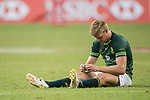 Philip Snyman of South Africa sits on the grass defeated, at the conclusion of the match South Africa vs New Zealand, Day 2 of the HSBC Singapore Rugby Sevens as part of the World Rugby HSBC World Rugby Sevens Series 2016-17 at the National Stadium on 16 April 2017 in Singapore. Photo by Victor Fraile / Power Sport Images