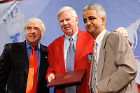 Kenny Cooper Sr., inductee Kyle Rote, Jr., and US Soccer President Sunil Gulati pose for photos during the induction ceremony for the National Soccer Hall of Fame at the New Meadowlands Stadium in East Rutherford, NJ, on August 10, 2010.