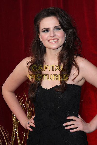 EMER KENNY.British Soap Awards 2010 at the London ITV Studios, South Bank, London, England..May 8th 2010.arrivals half length black strapless dress hands on hips.CAP/ROS.©Steve Ross/Capital Pictures.
