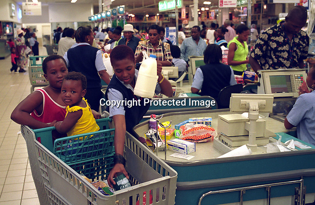 black, shopping cart, middle-class,children,food,.Unidentified people shopping at Southgate, a shopping mall outside Soweto, South Africa..©Per-Anders Pettersson/iAfrika Photos
