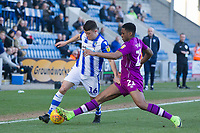 Kelvin Etuhu of Carlisle United with a timely intervention on Diaz Wright of Colchester United during Colchester United vs Carlisle United, Sky Bet EFL League 2 Football at the JobServe Community Stadium on 23rd February 2019