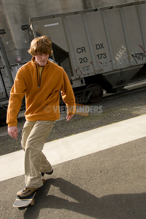 Teenage Boy Skateboarding in Industrial Portland, Oregon