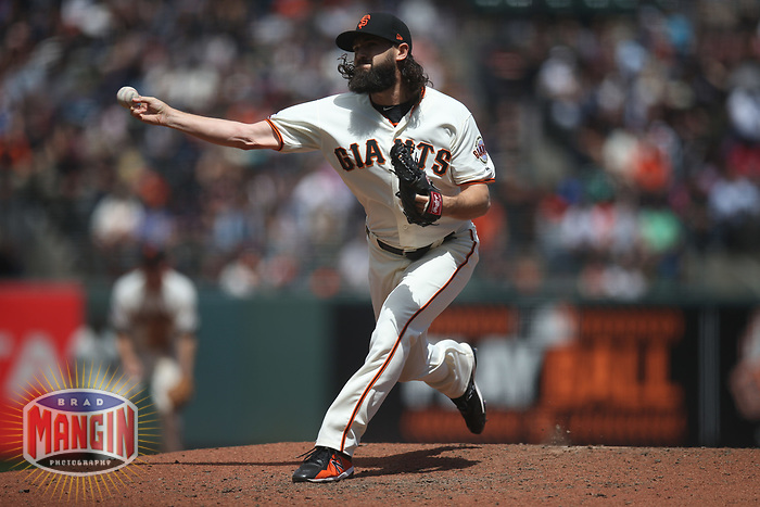 SAN FRANCISCO, CA - MAY 16:  Cory Gearrin #26 of the San Francisco Giants pitches against the Cincinnati Reds during the game at AT&T Park on Wednesday, May 16, 2018 in San Francisco, California. (Photo by Brad Mangin)