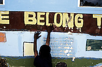 KLIPRIVER, SOUTH AFRICA APRIL 14: A blind boy touches a mural duringa break from class on April 14, 2003 at Sibonile (means: we have seen) School for the Blind in Klipriver, south of Johannesburg, South Africa. A blind woman founded the school in 1994. The school has about 125 students from disadvantaged communities around South Africa. Many of the children have faced rejection from their families and communities, and at Sibonile they have a chance for a good education. (Photo: Per-Anders Pettersson)..