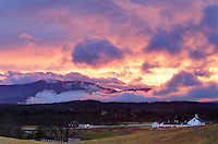 A two-day storm system ends with a spectacular sunset with color filing through low laying clouds on the Blue Ridge Mountains above Mirador in Crozet, VA. Photo/Andrew Shurtleff