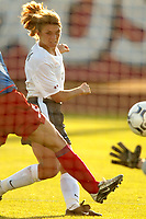 Mia Hamm watches the first of her two goals sail into the net.The USWNT defeated Russia 5-1 on  September 29, at Mitchel Athletic Complex, Uniondale, NY.