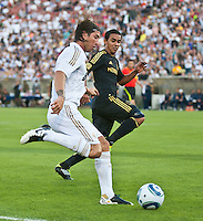 LOS ANGELES, CA – July 16, 2011: Sergio Ramos (4) of Real Madrid and Miguel Lopez (25) of the LA Galaxy during the match between LA Galaxy and Real Madrid at the Los Angeles Memorial Coliseum in Los Angeles, California. Final score Real Madrid 4, LA Galaxy 1.