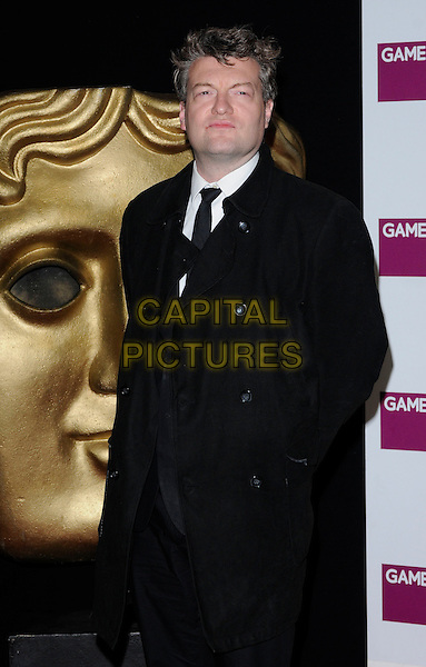 CHARLIE BROOKER .At the British Academy Video Games Awards, London HIlton Hotel, Park Lane, London, England, UK, March 19th 2010..BAFTA half length black coat tie trench mac .CAP/CAN.©Can Nguyen/Capital Pictures