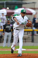 Edwin Diaz #45 of the Clinton LumberKings throws to first base against the Kane County Cougars at Ashford University Field on July 5, 2014 in Clinton, Iowa. The Cougars won 4-0.   (Dennis Hubbard/Four Seam Images)