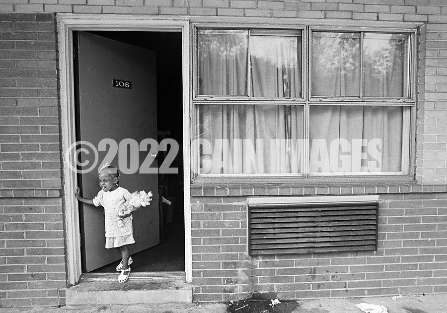 4 year old Dionna Thomas looks out the door at the George Washington Motor Lodge, where she and her mother are living Tuesday June 23, 1992 in Bensalem, Pennsylvania. (WILLIAM THOMAS CAIN / For The Philadelphia Inquirer)