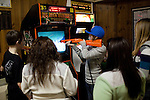 Teens play video games in Scotia, NY, on Saturday, December 26, 2009.