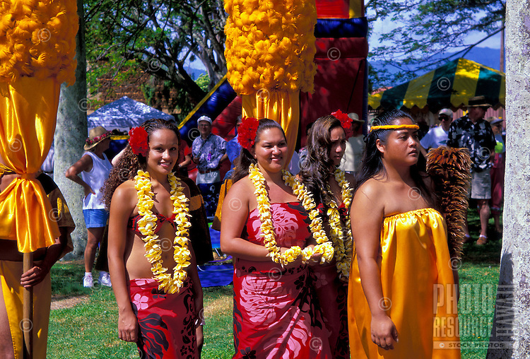 Members (women adorned with leis) of the Kings Royal court parade thru the town of Lihue on the island of Kauai,for the commencement of the annual Aloha Week celebration.
