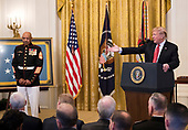 United States President Donald J. Trump awards the Medal of Honor to Sergeant Major John L. Canley, US Marine Corps (Retired), for conspicuous gallantry during the Vietnam War in a ceremony in the East Room of the the White House in Washington, DC on Wednesday, October 17, 2018.<br /> Credit: Ron Sachs / CNP