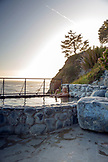 USA, California, Big Sur, Esalen, a woman sits in the Baths and takes in the evening view, the Esalen Institute