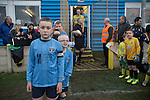 Club mascots wearing home team shirts prepare for the arrival of the players before the Boxing Day derby match between Runcorn Town and visitors Runcorn Linnets at the Pavilions, Runcorn, in a top-of the table North West Counties League premier division match. Runcorn Linnets won 1-0 and overtook their neighbours at the top of the league in a game watched by 803 spectators. Runcorn Linnets were a successor club to Runcorn FC, one of England foremost non-League clubs of the 1970s and 1980s.