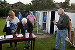 Daisy Hill 0 Colne 2, 01/09/2020. New Sirs, FA Cup extra preliminary round. Spectators writing their contact details for coronavirus contact tracing purposes inside the ground before Daisy Hill took on Colne in an FA Cup Extra-Preliminary round tie at New Sirs, Westhoughton, Greater Manchester. The visitors, who compete two divisions above their hosts, won this all-Lancashire match 2-0, watched by 241 spectators. The designated maximum capacity for the game had been set at 300 due to coronavirus pandemic restrictions which had recently been eased to allow spectators to attend non-League fixtures in England. Photo by Colin McPherson.