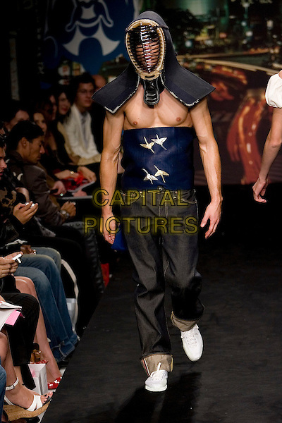 MODEL.Mercedes-Benz Spring 2007 L.A. Fashion Week - Evisu - Runway held at Smashbox Studios, Culver City, California, USA..October 15th, 2006.Ref: ADM/ZL.full length modelling catwalk black jeansd enim blue mask nipples chest.www.capitalpictures.com.sales@capitalpictures.com.©Zach Lipp/AdMedia/Capital Pictures.